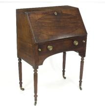 A Regency mahogany bureau on reeded legs with castors, 75cm wide