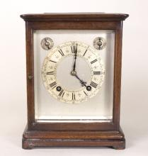 An oak cased four-glass eight-day mantel clock by Winterhalter & Hoffmeyer circa 1900, the two-train cylinder movement chiming on two gongs, with silvered dial, applied Roman numeral chapter ring, subsidiary Fast/Slow and Chime/Silent dials, in a rectangular bevel glazed case, 26cm high