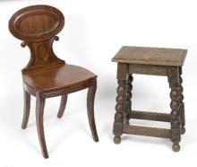An oak stool with bobbin turned legs and carved frieze and a mahogany hall chair