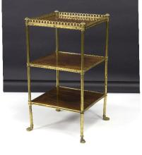 A Regency style rosewood three-tier étagère, the upper tier with gilt metal corner supports, with paw feet, 38cm wide