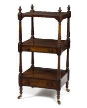 A 19th Century rosewood rectangular whatnot having three open tiers, the uppermost finished with turned finials, the middle and lower tiers each fitted a drawer, the middle drawer enclosing a fitted writing slope, 125cm high x 58cm wide/see illustration