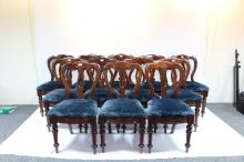 A set of twelve Victorian mahogany dining chairs, shaped backs with central splat on turned front legs