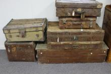 A quantity of leather suitcases, trunks etc.