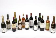 Thirteen bottles of various wine and champagne to include Chateau Lartigue de Brochon, 1986