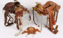 Two Western saddles, another of pony size and a miniature example