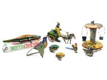 A group of tinplate toys to include a clockwork horse and cart, a carousel, a running goose etc.