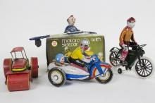A tinplate clockwork motorcycle and side car by Metal King, boxed, a clockwork figure riding a bicycle, a steam roller etc.