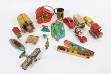 A quantity of tinplate toys to include a clockwork submarine, a clockwork tractor, a Clover toy car, a clockwork mini fair group etc.