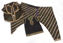 A group of Indian costumes to include a dress worked in gilt thread to a black cotton ground, a pair of black silk trousers worked with gilt floral bands and a similar jacket, another jacket and a child's top/see illustration