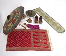 Two Indian turban hats, one embroidered with gilt thread and embellished with sequins, a pair of beaded shoes, a paisley worked shawl, a purse, a parasol and two others