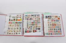 Three albums containing approximately 5000 late 20th Century World stamps