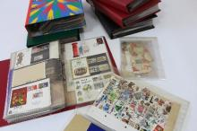Approximately 350 first day covers and definitive issues contained in six albums and a folder of loose stamps and other postal sundries