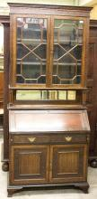 An Edwardian mahogany bureau bookcase, the blind fretwork glazed upper section enclosing shelves with cupboard beneath, 97cm wide x 219cm high