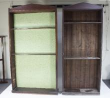 A near pair of 19th Century mahogany alcove bookcases with architectural pediments, one 111cm wide, the other 88cm wide