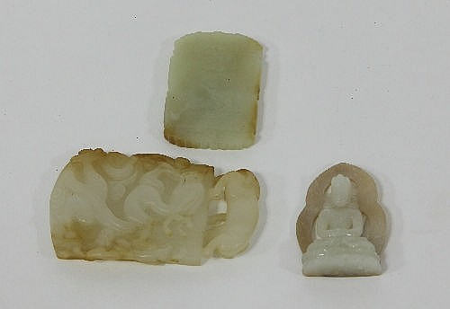 A Chinese jade plaque carved with dragon and with