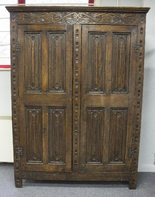 oak kitchen cabinet a carved oak cupboard enclosed by two linenfold panel doors 23848