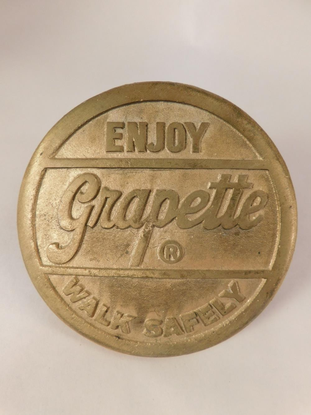 BRASS GRAPETTE SODA ADVERTISING SIDEWALK INSERT ORIGINAL ANTIQUES AND COLLECTIBLES