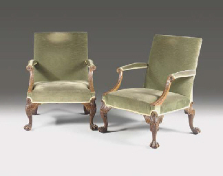 A PAIR OF GEORGE II MAHOGANY LIBRARY ARMCHAIRS