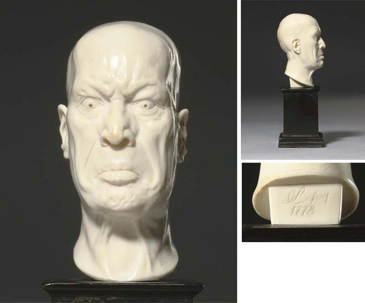 A CARVED IVORY HEAD OF A MAN