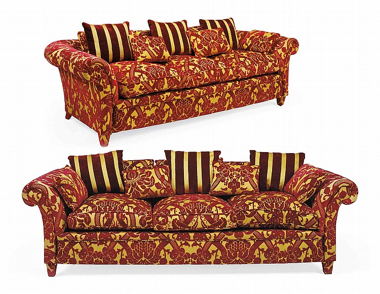 A PAIR OF SPANISH RED AND YELLOW CUT-VELVET CHESTERFIELD SOFAS