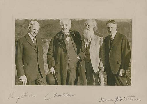 EDISON, Thomas Alva (1847-1931), Henry FORD (1863-1947), Harvey FIRESTONE (1868-1938) and JOHN BURROUGHS (1837-1921). Group photograph signed by Edison (