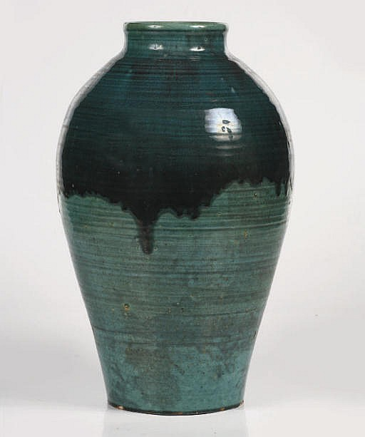 A large green glazed pottery vase