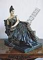 A French bronzed and polychrome-patinated white metal figure of a Belle Epoque lady, Georges