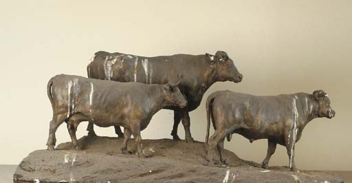A GEORGE III PATINATED PLASTER-ON-WIRE MODEL OF TWO BULLS AND A COW