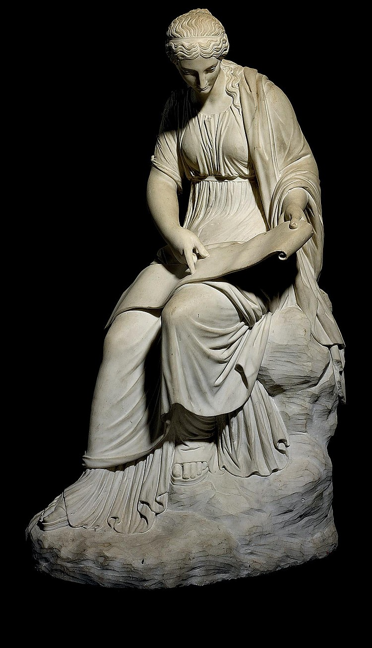 A CARVED MARBLE FIGURE OF THE MUSE CLIO