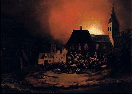 A burning village at night