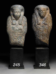 AN EGYPTIAN SERPENTINE SHABTI FOR PETAMENOPHIS