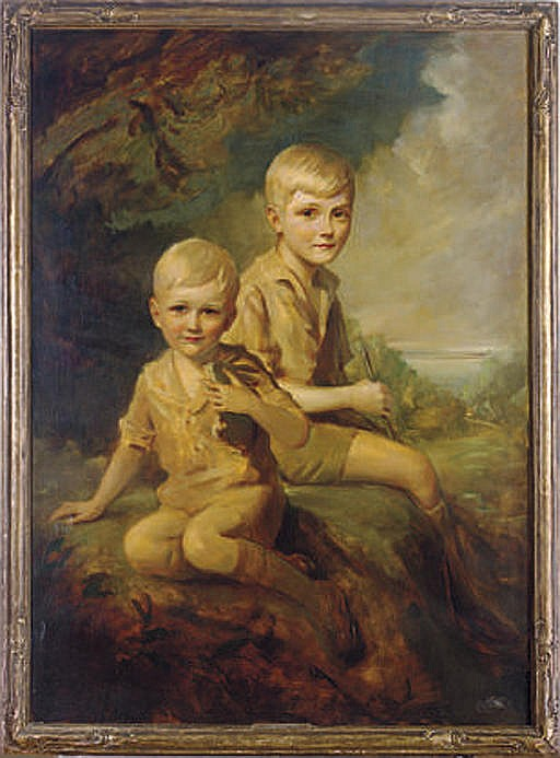 Portrait of two young boys seated in a verdant landscape