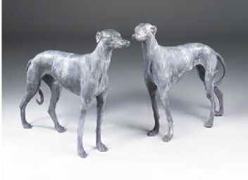 A pair of lead models of greyhounds