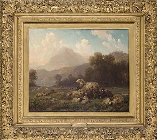 Sheep grazing, a mountainous landscape beyond