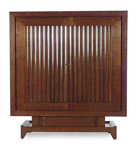 A FRENCH OAK CABINET,