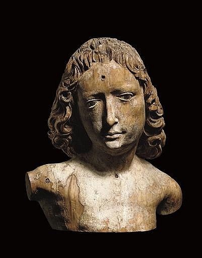 A FRAGMENTARY POLYCHROME CARVED WOOD BUST OF ST. SEBASTIAN