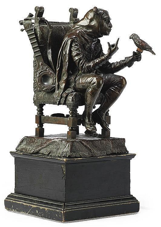 A GERMAN BRONZE GROUP OF A SEATED JESTER WITH A PARROT