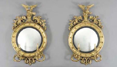 A PAIR OF LATE VICTORIAN GILTWOOD TWO-LIGHT CONVEX GIRANDOLE MIRRORS