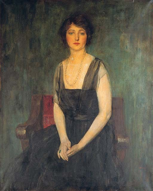 Portrait of Dorothy Duveen, three-quarter length, seated on a red chair