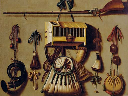 A  trompe l'oeil  still life with a gun, a bird in a cage, a hunting horn, gun powder, and other hunting implements hanging on a wall