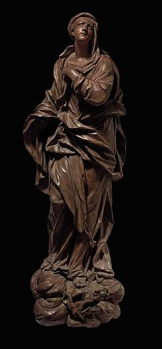 A TERRACOTTA FIGURE OF THE MADONNA OF THE IMMACULATE CONCEPTION