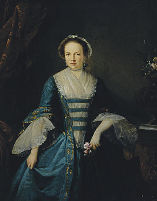 Portrait of a lady in a blue dress, three-quarter length, holding a rose