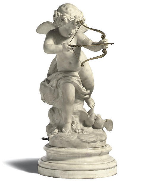 AN ITALIAN CARVED MARBLE MODEL OF CUPID