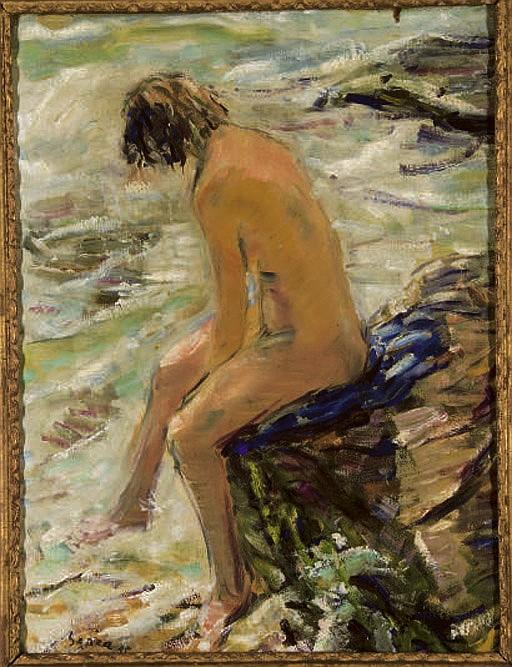Jeune femme au bord de la mer