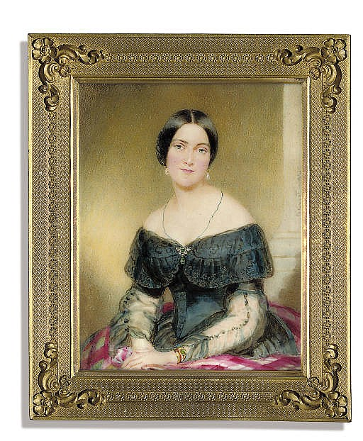A lady, seated in off-the-shoulder black dress with lace border, diaphanous sleeves, seated on a pink stole, emerald-set brooch at corsage, gold and emerald bracelet, drop-pearl earrings, dark hair swept back; column background