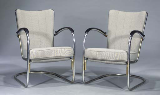 412, a pair of tubular steel easy-chairs