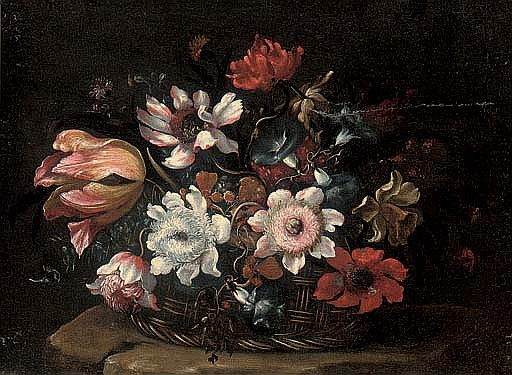 A tulip, morning glory, roses and other flowers in a wicker basket on a stone ledge