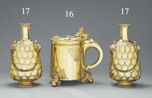 A pair of Victorian silver-gilt pilgrim flasks