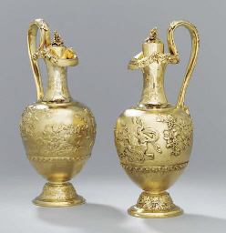A pair of Victorian silver-gilt claret-jugs