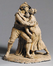 A TERRACOTTA GROUP OF A MAN, WOMAN AND CHILD EMBRACING